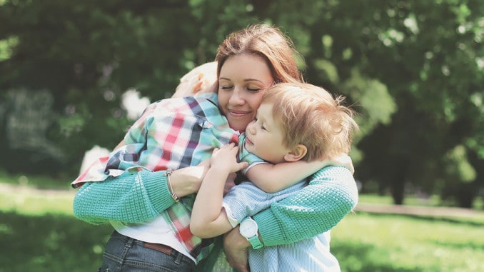 Mom Hugging Her Kids