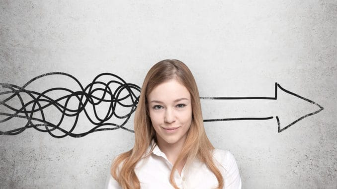 beautiful-woman-is-thinking-about-concept-of-business-development-a-huge-arrow-are-drawn-on-the-concrete-wall-57988489